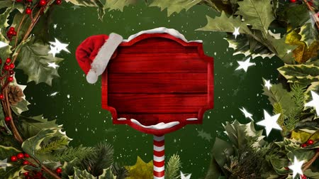 azevinho : Animation of red wooden sign board with Santa hat, snowflakes and stars falling on green background