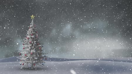seasons changing : Animation of winter scenery with snow falling and Christmas tree in the background