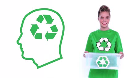 очистка : Animation of a young Caucasian woman wearing a green t-shirt with recycling sign, holding empty plastic box with recycling sign with green outline of human head with recycling sign inside next to her Стоковые видеозаписи