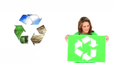 geri dönüşümlü : Animation of a young Caucasian woman wearing a green t-shirt with recycling sign, holding green sign with recycling sign with recycling sign next to her