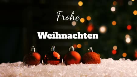 changing lights : Animation of the words Frohe Weihnachten written in white with Christmas tree and red baubles in the background Stock Footage