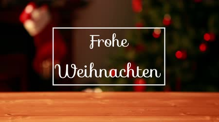 changing lights : Animation of the words Frohe Weihnachten written in white in white frame with Christmas tree and flickering fairy lights in the background
