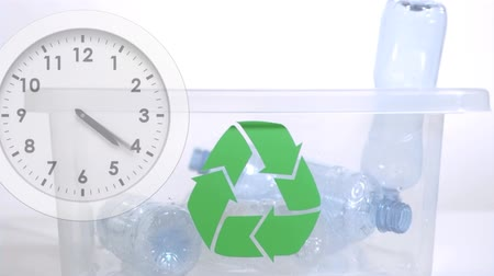 ticking : Animation of plastic bottles falling into plastic box with recycling sign and clock ticking fast on white background