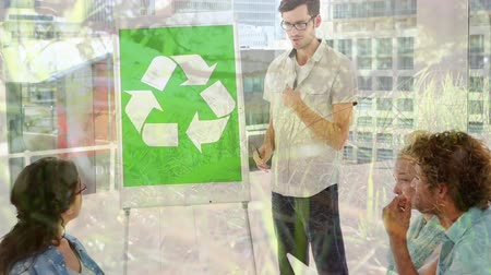 clareira : Animation of a group of multi-ethnic male and female colleagues talking during a presentation next to whiteboard with recycling sign with countryside moving in the foreground