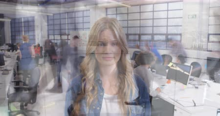 pace : Animation of young Caucasian professional woman smiling to camera with multi-ethnic team of male and female professionals in busy office in fast motion with commuters passing in the foreground 4k