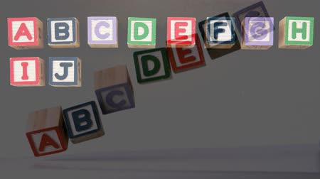 zęby : Animation of colourful wooden blocks arranged in rows in alphabetical order