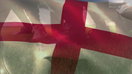 zift : Animation of English flag waving over a rugby ball and players at a sport stadium