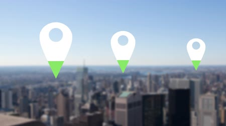 wijzer : Animation of location pins filling up with green color over cityscape in the background Stockvideo