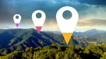 wijzer : Animation of location pins filling up with pink, yellow and purple color over sunny green mountain landscape in the background Stockvideo