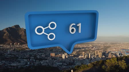 wijzer : Animation of blue speech bubble with search symbol filling up with numbers from zero to one hundred over cityscape with mountain and blue sky in the background Stockvideo
