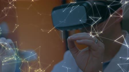 biotechnologia : Animation of man in VR headset touching virtual screen in a laboratory Wideo