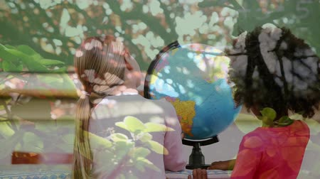 environmental awareness : Animation of two schoolgirls using globe at school with trees in the foreground