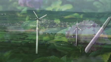 odpowiedzialność : Animation of turning wind turbines with flowers in the foreground