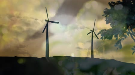 environmental awareness : Animation of turning wind turbines with trees in the foreground