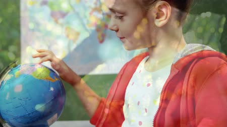 environmental awareness : Animation of schoolboy using globe at school with trees in the foreground