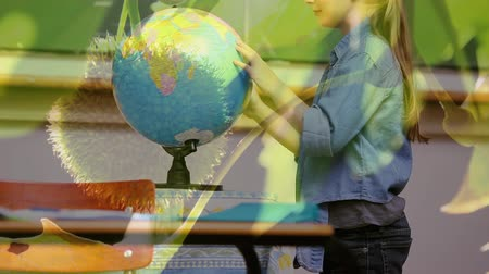 sustainable resources : Animation of schoolgirl spinning globe at school with trees in the foreground