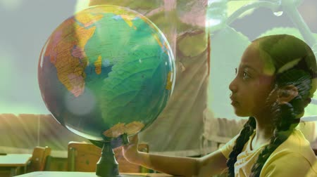 odpowiedzialność : Animation of mixed race schoolgirl using globe at school with tree and water dropping in the foreground