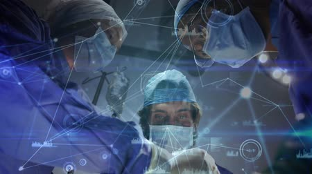 cirurgião : Animation of network of connections moving over surgeons in the operating theatre Stock Footage