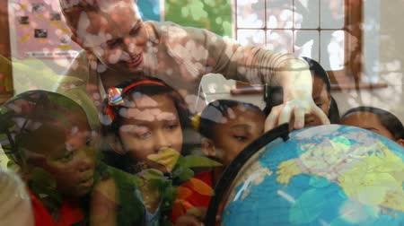 udržitelnost : Animation of female teacher and multi-ethnic school children using globe at school with trees in the foreground