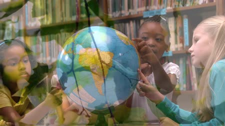 environmental awareness : Animation of multi-ethnic schoolgirls using globe at school with trees in the foreground