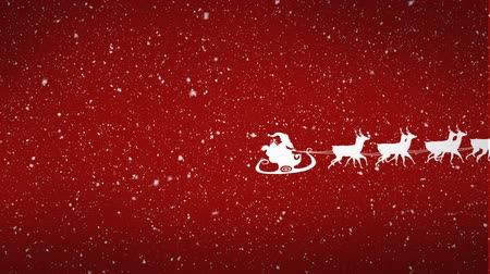 sob : Animation of a white silhouette of Santa Claus in sleigh being pulled by reindeers with snow falling on red background Dostupné videozáznamy