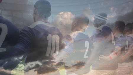 marş : Animation of rugby players embracing and singing anthem before the match at a stadium with clouds in the foreground