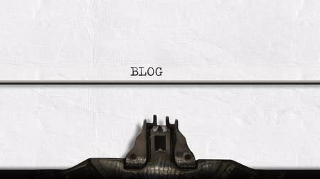 impressão digital : Animation of a close up of the type guard and moving type bars of a typewriter, typing out the word Blog in capital letters on plain white paper, in slow motion Stock Footage