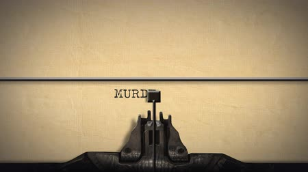 papeteria : Animation of a close up of the type guard and moving type bars of a typewriter, typing out the word Murder in capital letters on cream coloured paper Wideo