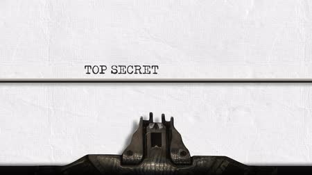 аналог : Animation of a close up of the type guard and moving type bars of a typewriter, typing out the words Top Secret in capital letters on plain white paper Стоковые видеозаписи