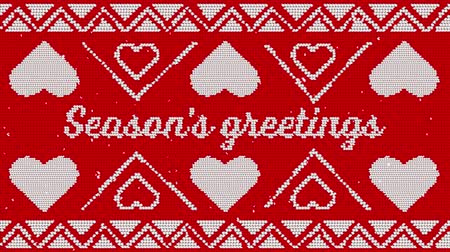 seasons changing : Animation of the words Seasons Greetings written in white on red fabric with Christmas pattern. Festive christmas concept. Stock Footage