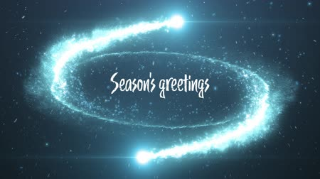 seasons changing : Animation of the words Seasons Greetings written in white with blue sparkling fireworks rotating on black background. Festive christmas concept.