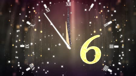seis : Animation of countdown on New Year Eve, from ten to zero in yellow numbers with ticking clock, fireworks and golden confetti in the background