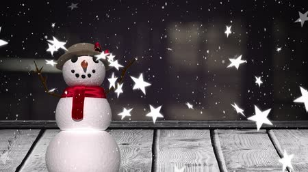 kardan adam : Animation of winter scenery with snowflakes and stars falling, snowman and wooden boards in the background