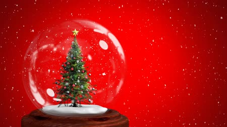 冬 : Animation of Christmas snow globe with Christmas tree inside and snow falling on red background