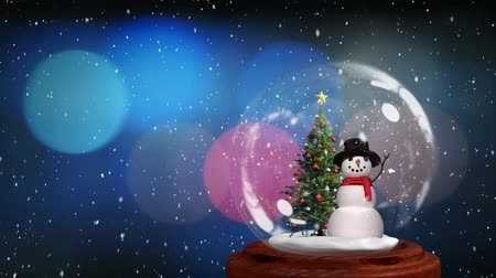 snow globe : Animation of Christmas snow globe with Christmas tree and snowman inside and snow falling with flickering lights in the background