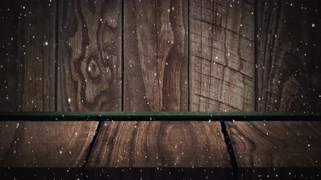 colour design : Animation of snowflakes falling and wooden boards in the background