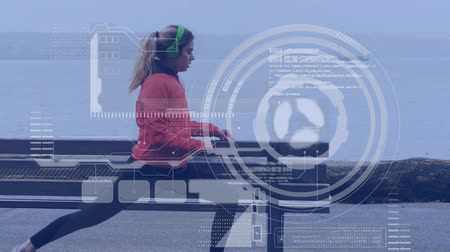 measuring : Animation of data processing with a young woman stretching with headphones on in the background Stock Footage