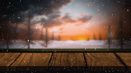 abeto : Animation of winter scenery with snowflakes falling, fir trees in countryside and wooden boards in the background
