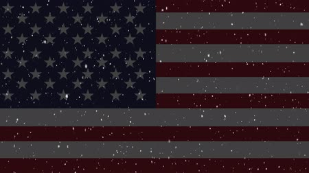 spangled : Animation of snow falling in winter with an American flag in the background