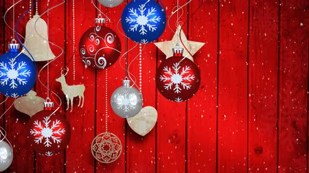 önemsiz şey : Animation of snow falling and Christmas decorations with baubles on red wooden background