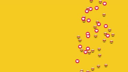 emoticon : Animation of group of emojis and heart icons falling on yellow background Stock Footage