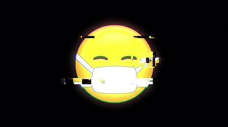 emoticon : Animation of  emoji icon with face mask flickering on black background Stock Footage