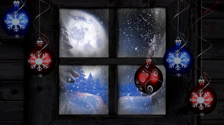 seasons changing : Animation of winter scenery seen through window with snowflakes falling, moon and countryside with five red and blue Christmas baubles in the foreground