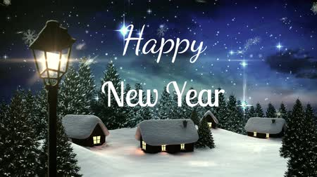 seasons changing : Animation of the words Happy New Year written in white letters with snowflakes falling at night in countrsyide
