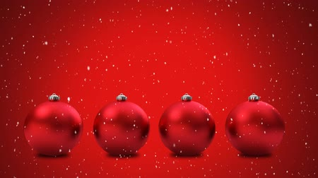 önemsiz şey : Animation of snow falling with four red baubles Christmas decoration on red background
