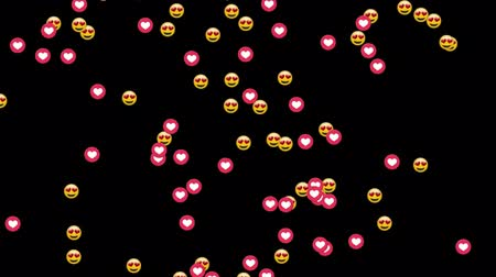 emoticon : Animation of group of emojis and heart icons falling on black background