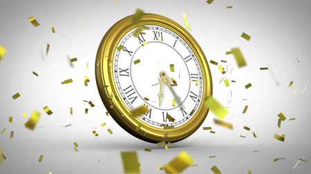 ticking : Animation of fast moving clock with golden confetti falling on white background Stock Footage