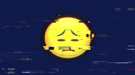 emoticon : Animation of sad emoji flickering on blue background Stock Footage