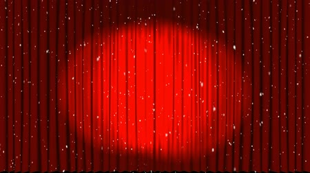 kino : Animation of spotlights on red curtains revealing Christmas glowing lights floating on black background