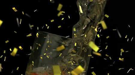flet : Animation of strawberry falling into a full champagne glass with golden confetti during New Year Eve celebrations on black background Wideo
